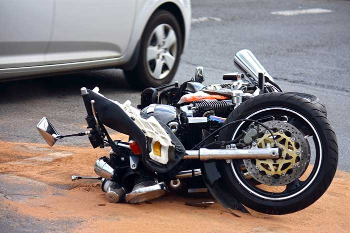 A motorcycle on its side in the road after an accident in Albany.