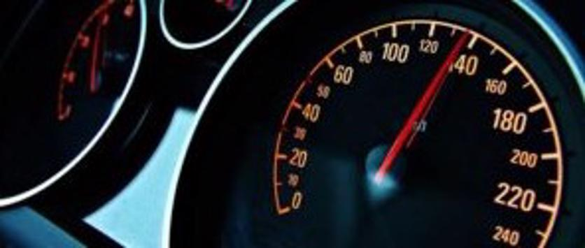 This image shows a car speedometer at 140 mph.