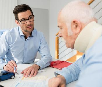 This image shows an Albany personal injury attorney speaking with a client.