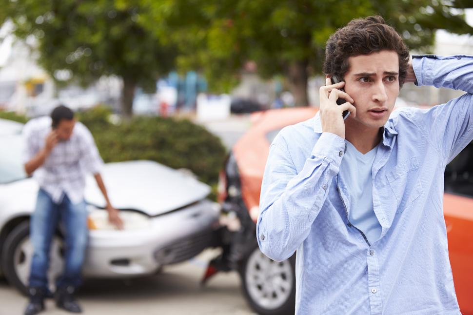 A man on the phone with an attorney after a car accident in Albany, GA.
