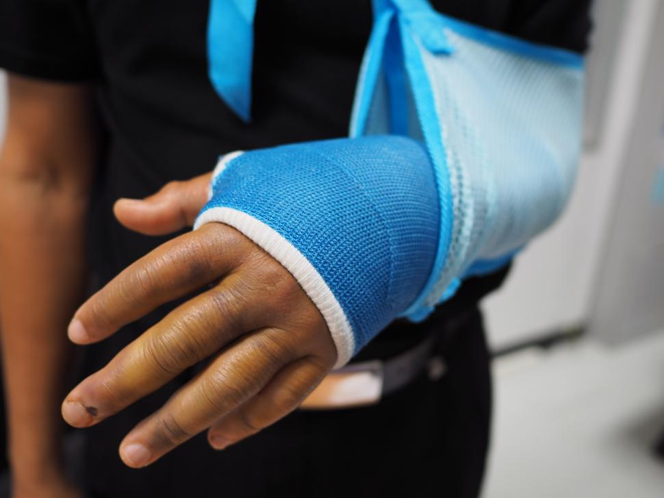 A person with an arm injury from a car accident.