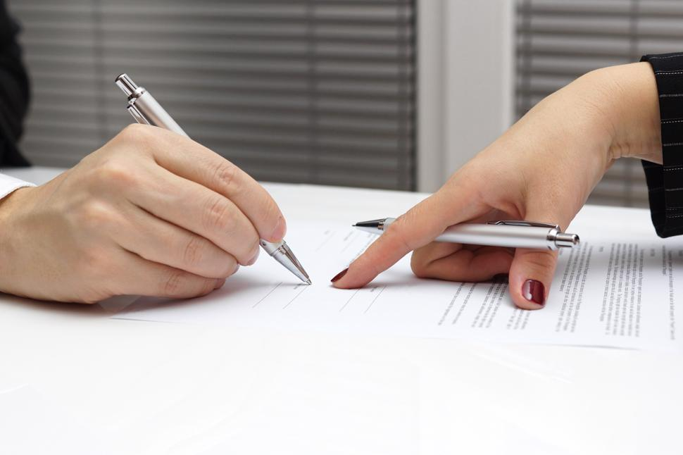 A car accident lawyer negotiating an insurance settlement.
