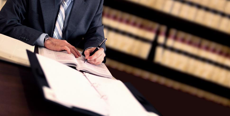 A personal injury lawyer reviewing documents for a case.