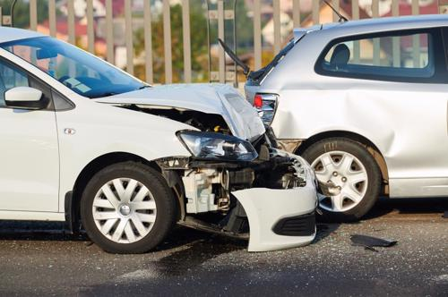 Extensive damage to the front end of a car after an accident.