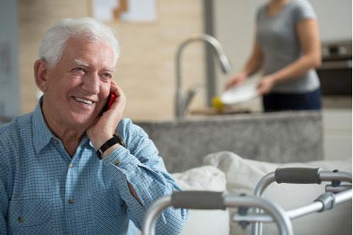 Elderly man calling Columbus medical malpractice lawyer