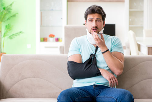 Young man with neck and arm injury calling Columbus pedestrian accident lawyer