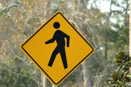 Yellow pedestrian crossing sign