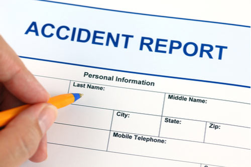 A person filling out an accident report after being injured.
