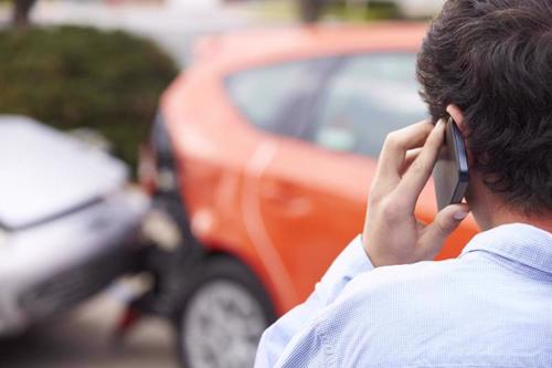 A man calling a Columbus car accident lawyer after being rear-ended.